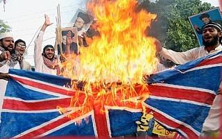 Muslims burning union jack