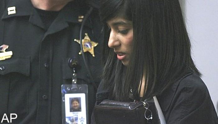 Rifqa Bary, 17, hugs a Bible